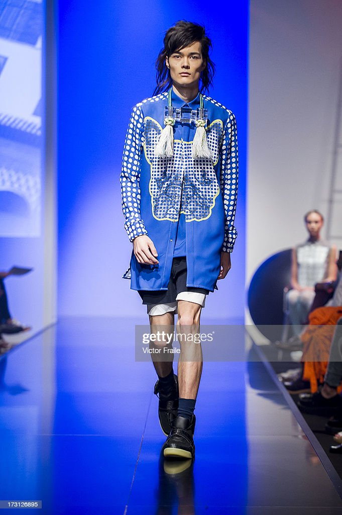 Model showcases designs of Kenex Leung on the runway during the Fashionally Collection #2 show on day 1 of Hong Kong Fashion Week Spring/Summer 2013 at the Hong Kong Convention and Exhibition Centre on July 8, 2013 in Hong Kong, China.