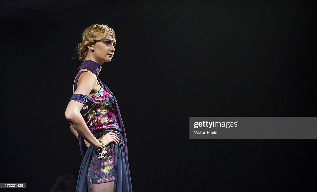 A model showcases designs of MaConsef on the runway during the Macao Fashion Parade on day 2 of Hong Kong Fashion Week Spring/Summer 2013 at the Hong Kong Convention and Exhibition Centre on July 9, 2013 in Hong Kong, China.
