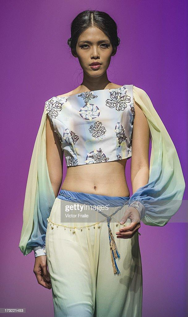 A model showcases designs of MaConsef on the runway during the Macao Fashion Parade on day 2 of Hong Kong Fashion Week Spring/Summer 2013 at the Hong Kong Convention and Exhibition Centre on July 9, 2013 in Hong Kong, China.