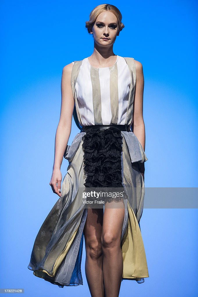 A model showcases designs of Nega C on the runway during the Designer Collection Show on day 2 of Hong Kong Fashion Week Spring/Summer 2013 at the Hong Kong Convention and Exhibition Centre on July 9, 2013 in Hong Kong, China.