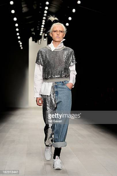 A model showcases designs on the catwalk by Ashish on day 5 of London Fashion Week Spring/Summer 2013 at The Courtyard Show Space on September 18...