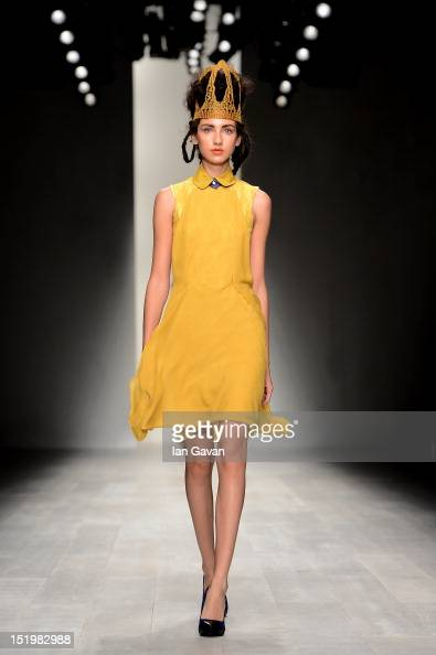 A model showcases designs on the catwalk by Bora Aksu on day 1 of London Fashion Week Spring/Summer 2013 at the Courtyard Show Space on September 14...