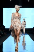 A model showcases designs on the catwalk by designer Sisca Tjong during Jakarta Fashion Week 2012 show at Pacific Place on November 16 2011 in...