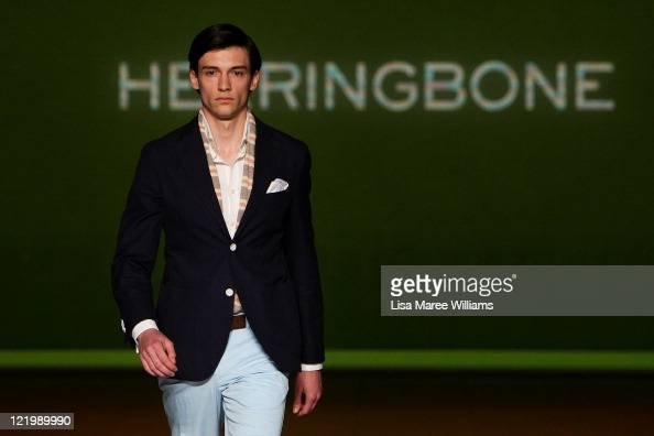 A model showcases designs on the catwalk by Herringbone during GQ Presents Boys Of The Australian Fashion Festival as part of Mercedes Benz Fashion...
