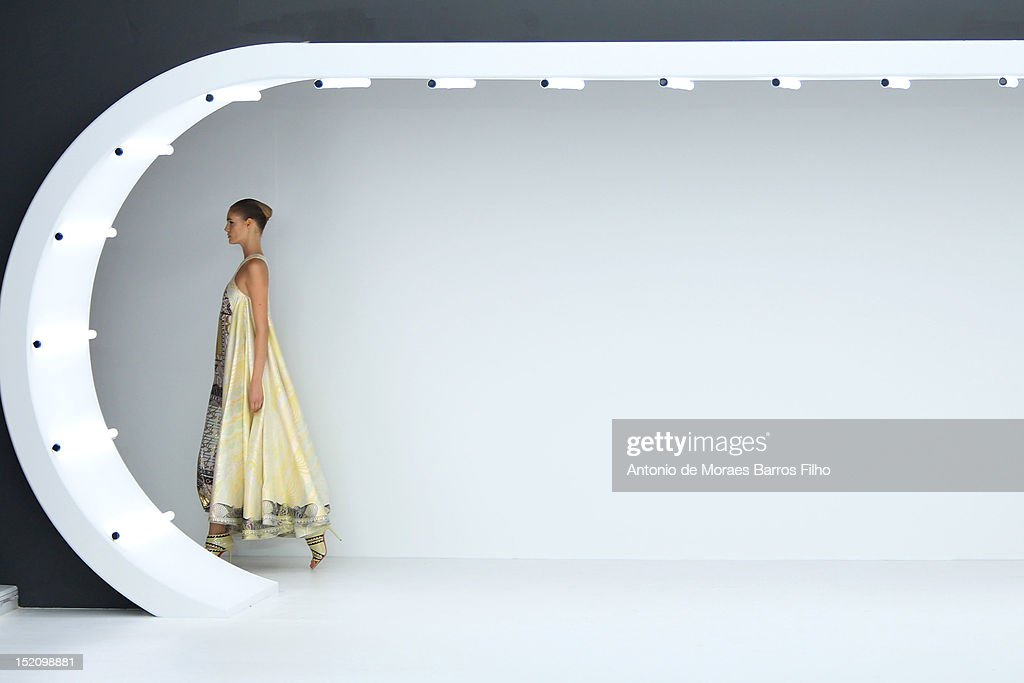 A model showcases designs on the catwalk by Mary Katrantzou on day 3 of London Fashion Week Spring/Summer 2013, at The Topshop Venue on September 16, 2012 in London, England.
