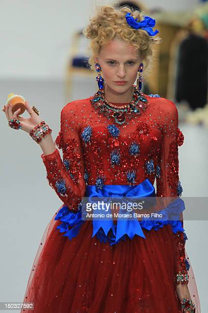 A model showcases designs on the catwalk by Meadham Kirchhoff on day 5 of London Fashion Week Spring/Summer 2013 at The Topshop Venue on September 18...