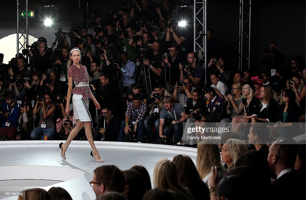 A model showcases designs on the catwalk by Michael van der Ham on day 4 of London Fashion Week Spring/Summer 2013, at The Topshop Venue on September 17, 2012 in London, England.