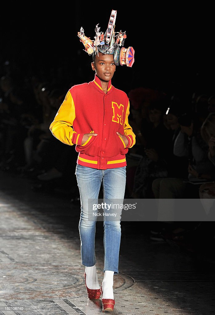 A model showcases designs on the catwalk by Philip Treacy on day 3 of London Fashion Week Spring/Summer 2013, at The Royal Courts Of Justice on September 16, 2012 in London, England.