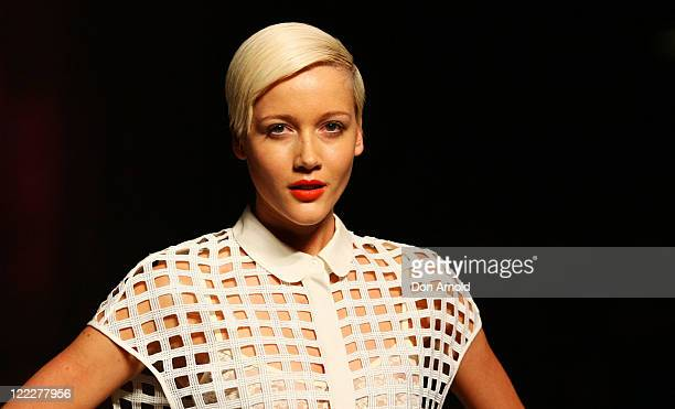 A model showcases designs on the catwalk by White Suede during A Review of Australian Fashion Week show as part of Mercedes Benz Fashion Festival...