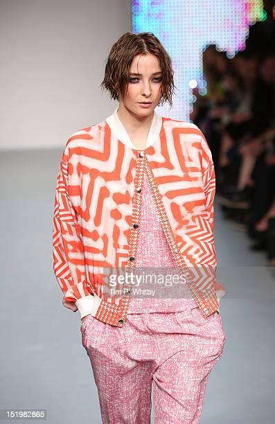 A model showcases designs on the catwalk by Zoe Jordan on day 1 of London Fashion Week Spring/Summer 2013 at Mercer Street Studios on September 14...