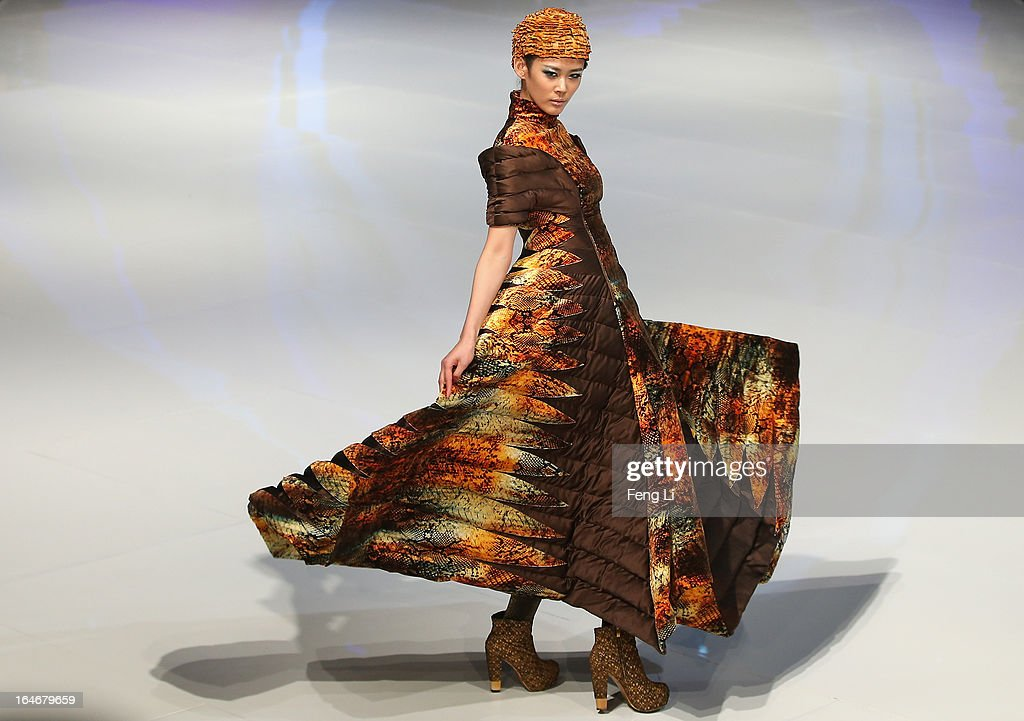 A model showcases designs on the catwalk during Bosideng Down Wear Collection on the third day of Mercedes-Benz China Fashion Week Autumn/Winter 2013/2014 at 751 D.PARK Workshop on March 26, 2013 in Beijing, China.