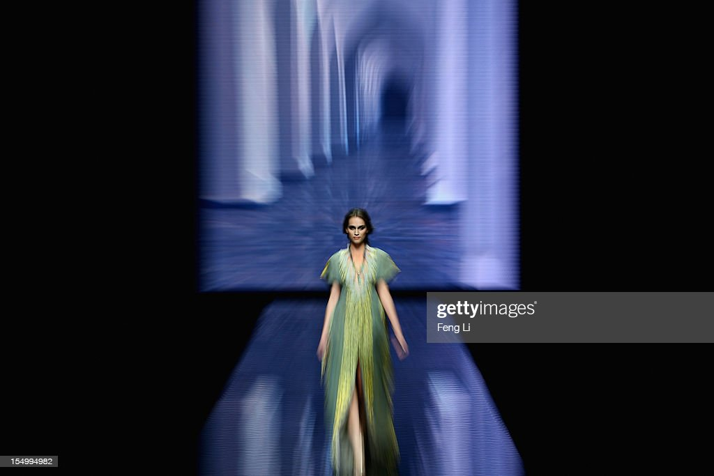 A model showcases designs on the catwalk during Guli Collection of China Fashion Week S/S Collection 2013 on October 30, 2012 in Beijing, China.