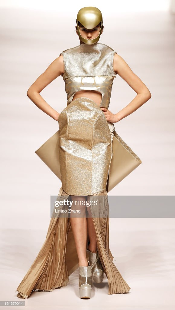A model showcases designs on the catwalk during Hempel Award the 21st China International Young Fashion Designers Contest on the second day of Mercedes-Benz China Fashion Week Autumn/Winter 2013/2014 at Banquet Hall of Beijing Hotel on March 25, 2013 in Beijing, China.