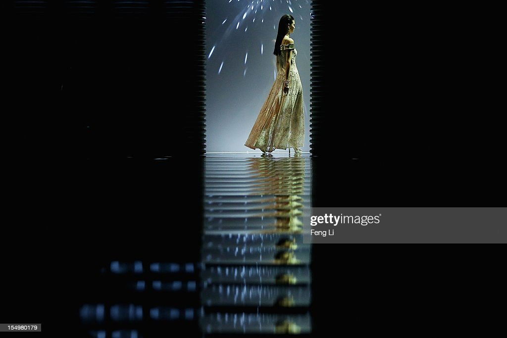 A model showcases designs on the catwalk during KORADIOR Fang Ying Collection of China Fashion Week Spring/Summer 2013 on October 29, 2012 in Beijing, China.