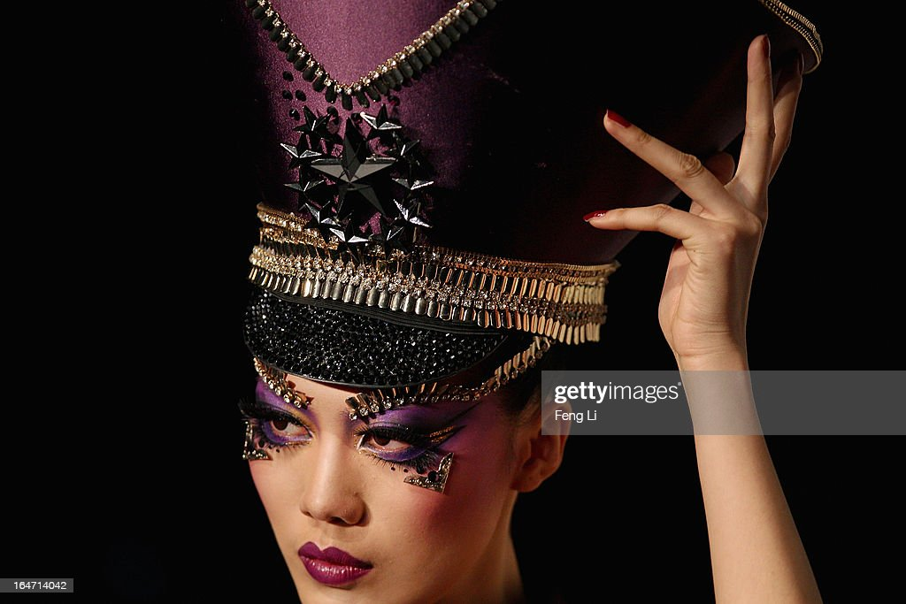 A model showcases designs on the catwalk during MGPIN Make-up Styling Collection on the fourth day of Mercedes-Benz China Fashion Week Autumn/Winter 2013/2014 at 751 D.PARK Workshop on March 27, 2013 in Beijing, China.