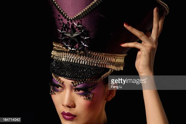 A model showcases designs on the catwalk during MGPIN Makeup Styling Collection on the fourth day of MercedesBenz China Fashion Week Autumn/Winter...
