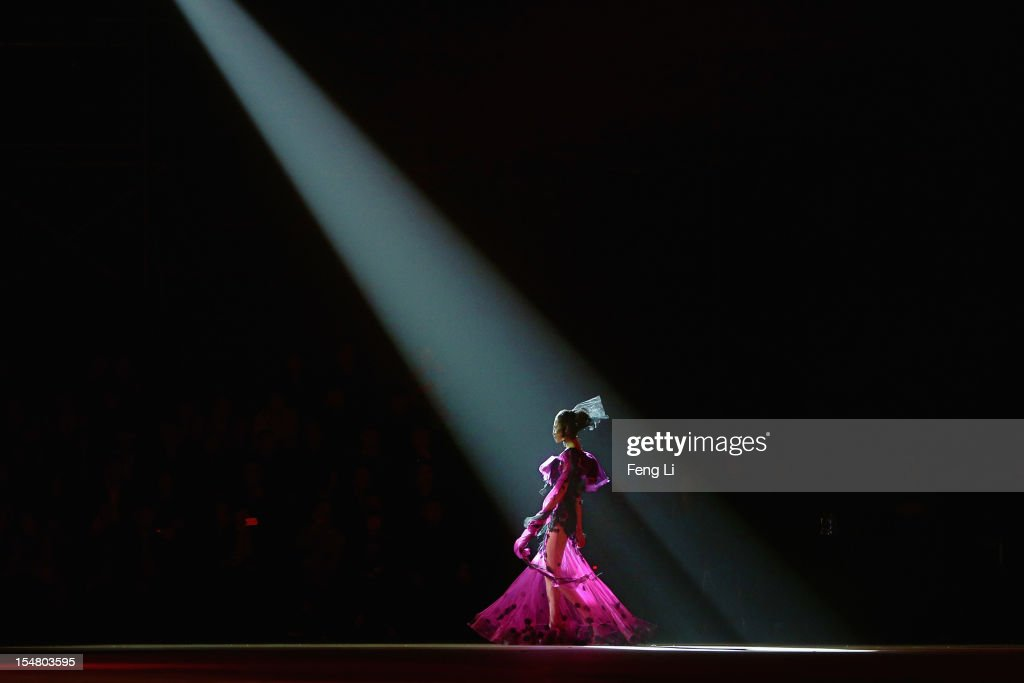 A model showcases designs on the catwalk during SEC Qi Gang Collection of China Fashion Week Spring/Summer 2013 on October 26, 2012 in Beijing, China.