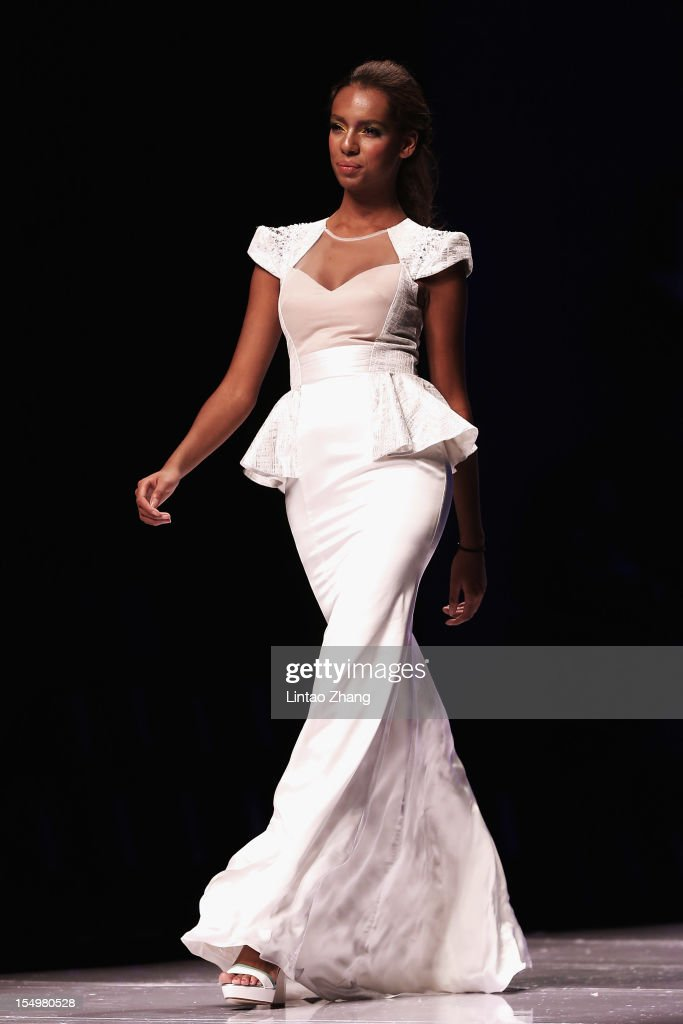 A model showcases designs on the catwalk during the Asahi Kasei Creativity Award Dorian Ho Collection of China Fashion Week S/S Collection 2013 at Beijing Hotel on October 29, 2012 in Beijing, China.