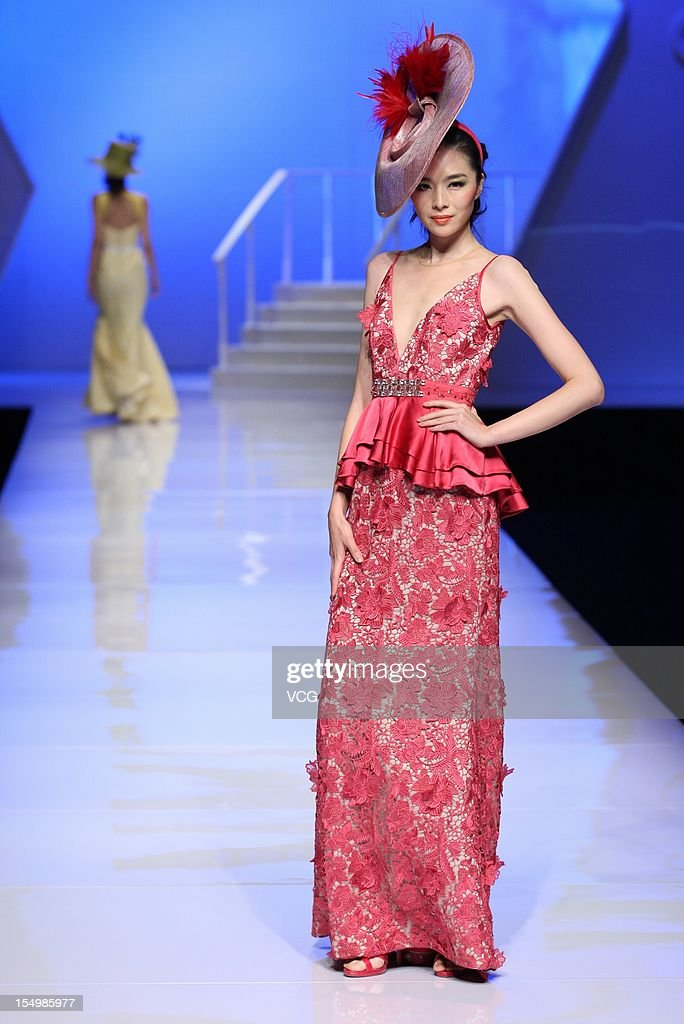 A model showcases designs on the catwalk during the Asahi Kasei Creativity Award Dorian Ho collection show on the fifth day of China Fashion Week S/S Collection 2013 at Beijing Hotel on October 29, 2012 in Beijing, China.