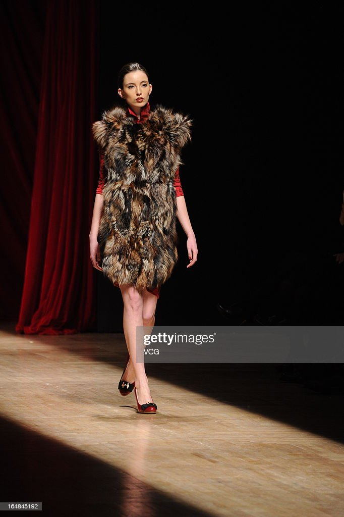 A model showcases designs on the catwalk during the Asahi Kasei Creativity Award Wang Yutao collection show on the fifth day of Mercedes-Benz China Fashion Week Autumn/Winter 2013/2014 at Beijing Hotel on March 28, 2013 in Beijing, China.
