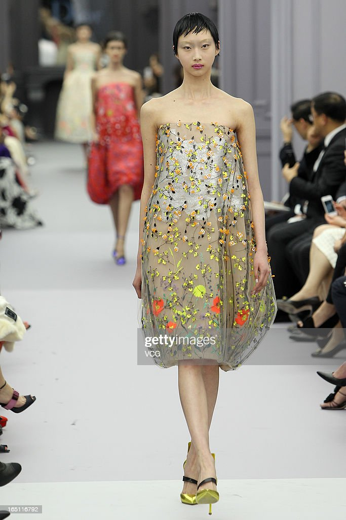 A model showcases designs on the catwalk during the Christian Dior S/S 2013 Haute Couture Collection at Five on the Bund on March 30, 2013 in Shanghai, China.