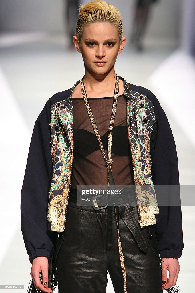 A model showcases designs on the catwalk during the DDU collection show on the third day of Mercedes-Benz China Fashion Week Autumn/Winter 2013/2014 at Beijing Hotel on March 26, 2013 in Beijing, China.