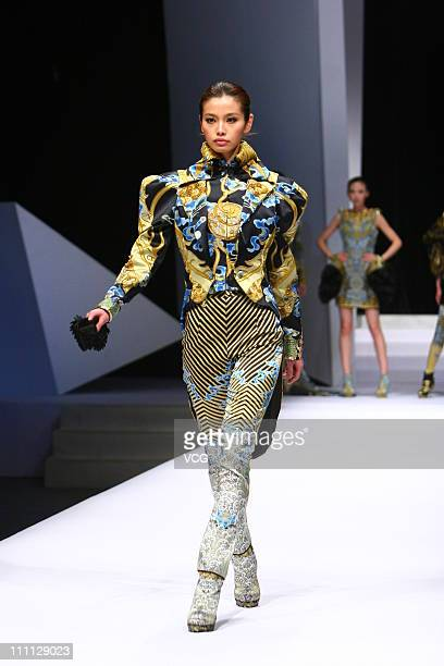 A model showcases designs on the catwalk during the DHL Fashion Express College Students Fashion Design Conference on the sixth day of China Fashion...