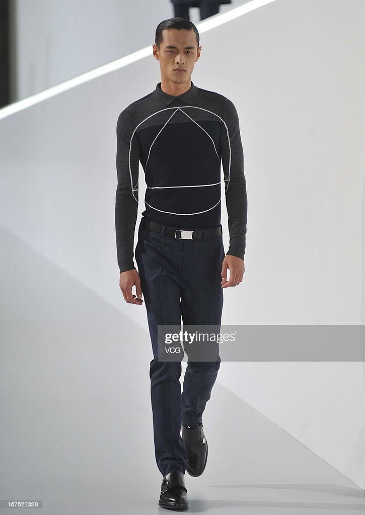A model showcases designs on the catwalk during the Dior Homme F/W 2013 Menswear Collection Show on April 25, 2013 in Beijing, China.