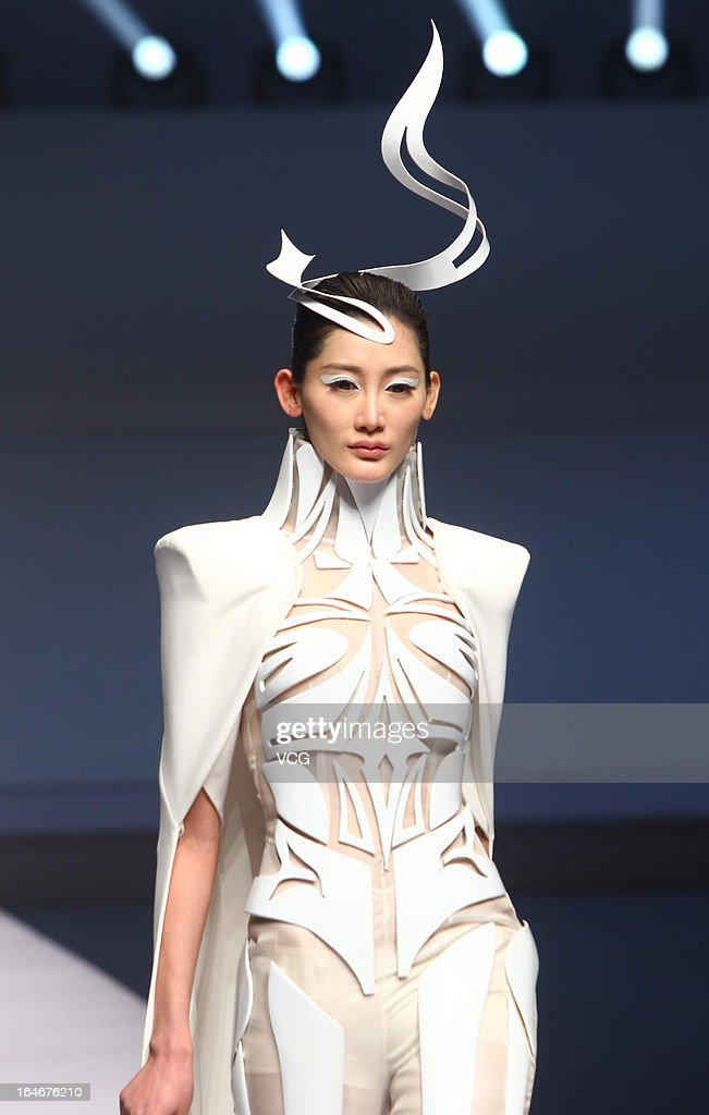 A model showcases designs on the catwalk during the Hempel Award the 21st China International Young Fashion Designers Contest on the second day of Mercedes-Benz China Fashion Week Autumn/Winter 2013/2014 at Beijing Hotel on March 25, 2013 in Beijing, China.