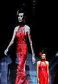 A model showcases designs on the catwalk during the LT Pro Launching on day one of Jakarta Fashion Week 2009 at the Fashion Tent Pacific Place on...