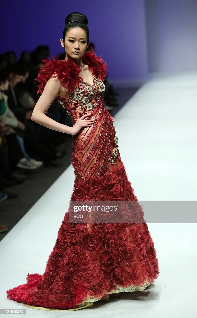 A model showcases designs on the catwalk during the LU Classic Lu Weixing Dress collection show on the fifth day of Mercedes-Benz China Fashion Week Autumn/Winter 2013/2014 at 751 D.PARK Central Hall on March 28, 2013 in Beijing, China.