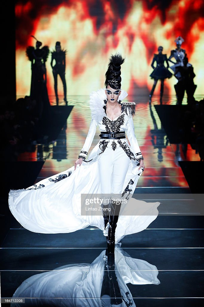 A model showcases designs on the catwalk during the MGPIN Collection on the four th day of Mercedes-Benz China Fashion Week Autumn/Winter 2013/2014 at 751 D.PARK Workshop on March 27, 2013 in Beijing, China.