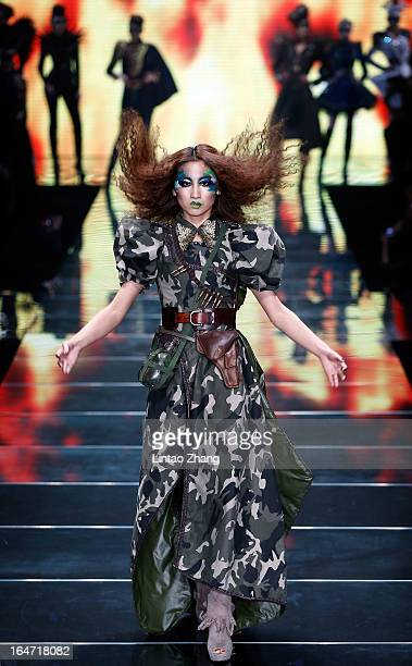A model showcases designs on the catwalk during the MGPIN Collection on the four th day of MercedesBenz China Fashion Week Autumn/Winter 2013/2014 at...