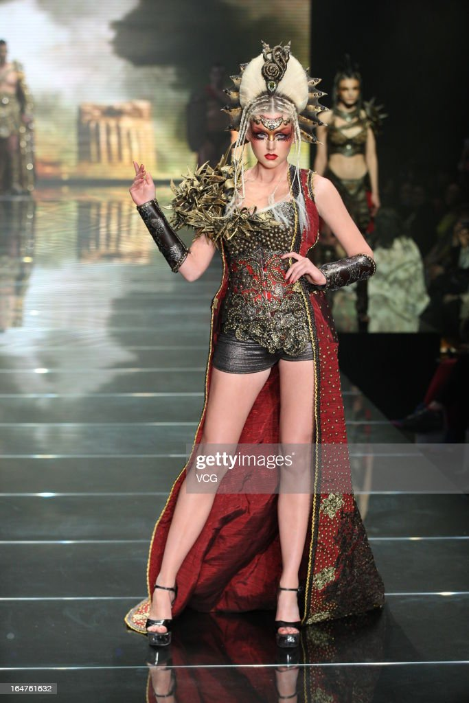 A model showcases designs on the catwalk during the MGPIN collection show on the fourth day of Mercedes-Benz China Fashion Week Autumn/Winter 2013/2014 at 751 D.PARK Workshop on March 27, 2013 in Beijing, China.