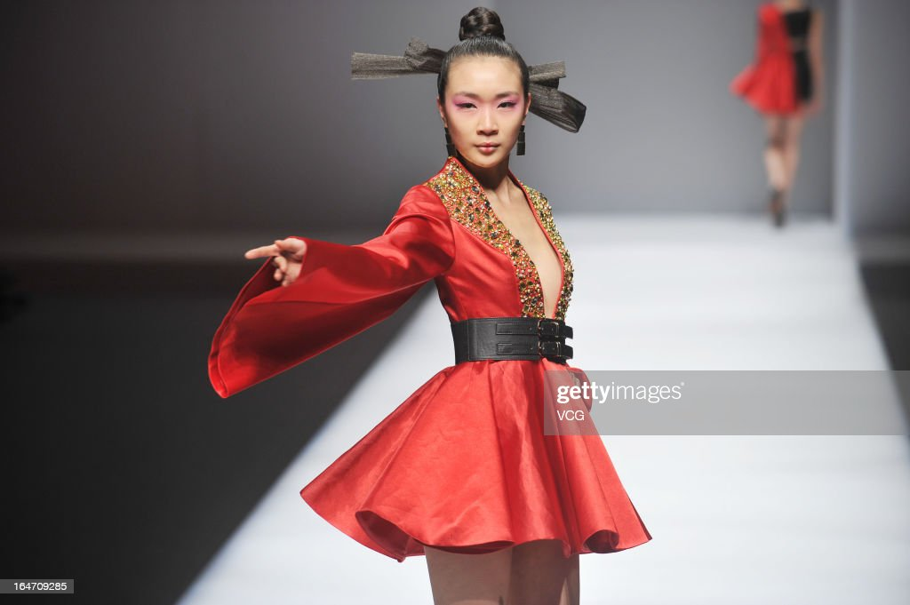 A model showcases designs on the catwalk during the Minzu University of China collection show on the fourth day of Mercedes-Benz China Fashion Week Autumn/Winter 2013/2014 at Beijing Hotel on March 27, 2013 in Beijing, China.