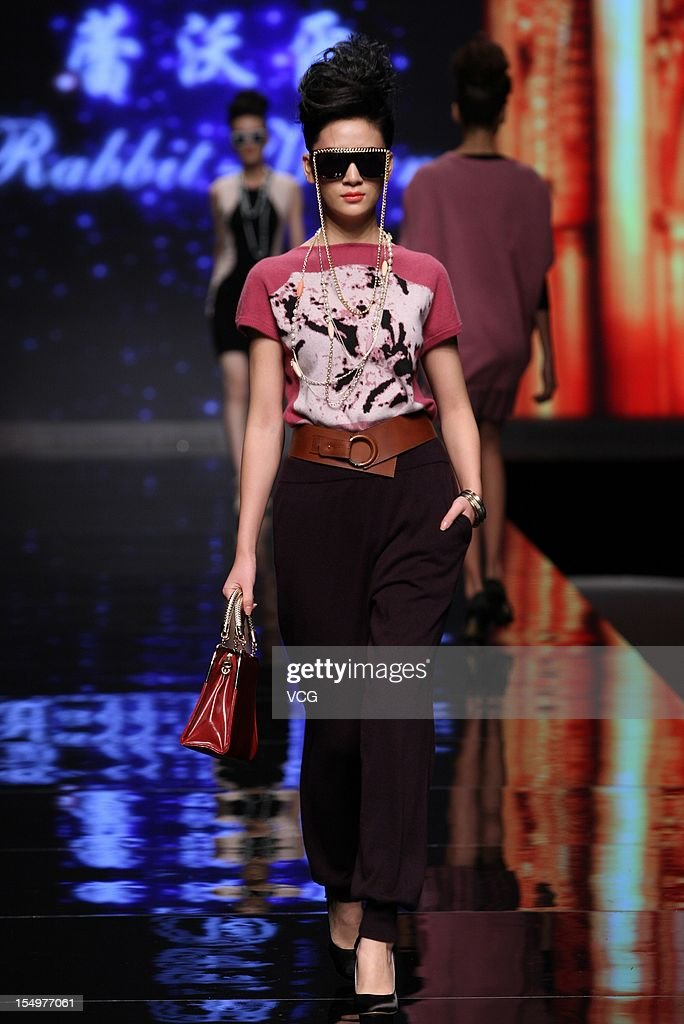 A model showcases designs on the catwalk during the Rabbit WarmZhuang Ganran collection show on the fifth day of China Fashion Week S/S Collection 2013 at Beijing Hotel on October 29, 2012 in Beijing, China.