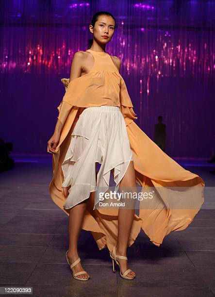 A model showcases designs on the catwalk during the Review Show as part of Mercedes Benz Fashion Festival Sydney 2011 at Sydney Town Hall on August...