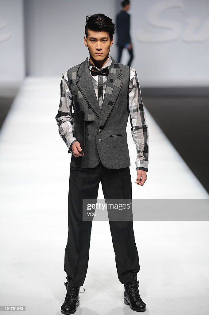 A model showcases designs on the catwalk during the SUNDANCE CUP China Men's Business Fashion Design Contest on the fourth day of Mercedes-Benz China Fashion Week Autumn/Winter 2013/2014 at Beijing Hotel on March 27, 2013 in Beijing, China.