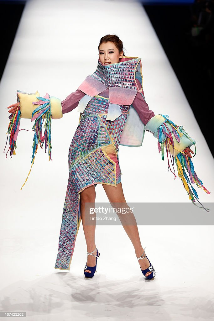 A model showcases designs on the catwalk during the Tianjin Polytechnic University School of Art and Clothing Graduates Show on the second day of China Graduate Fashion Week at 751D.PARK Workshop on April 25, 2013 in Beijing, China.