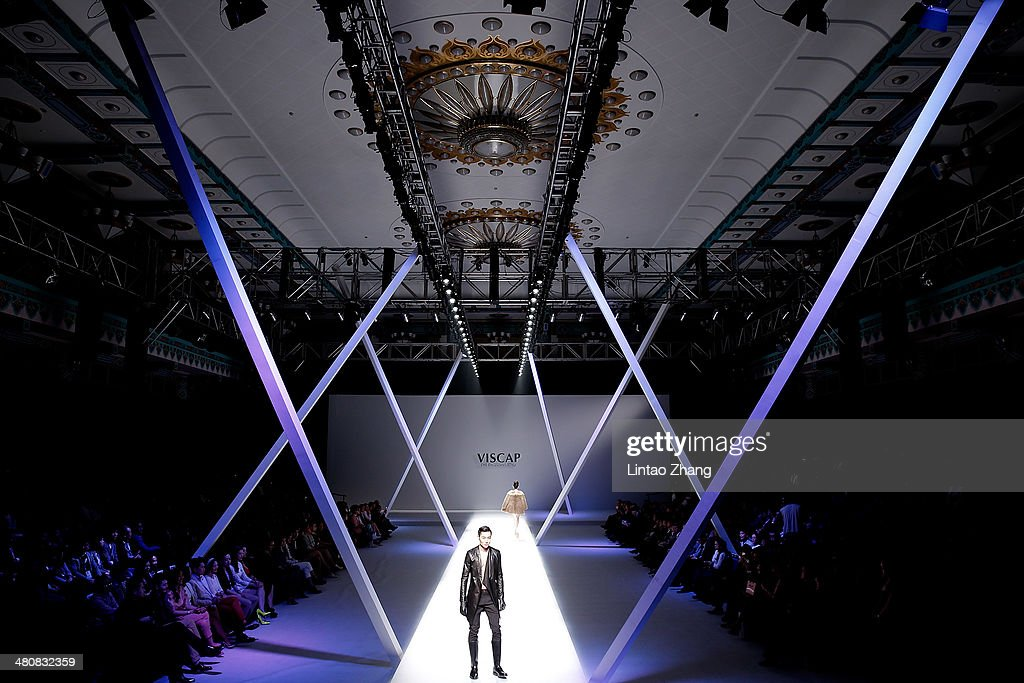 A model showcases designs on the catwalk during the VISCAP Korman Yuan Bin Collection show on the third day of Mercedes-Benz China Fashion Week Autumn/Winter 2014/2015 at the Banquet Hall, Beijing Hotel on March 27, 2014 in Beijing, China.