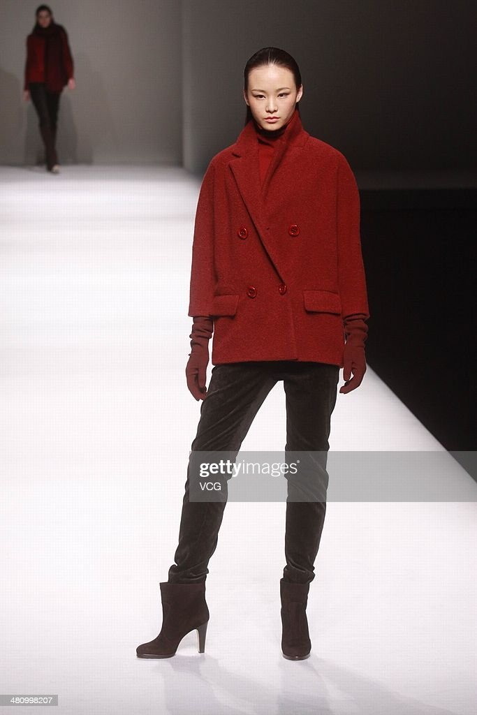 A model showcases designs on the catwalk during the WFbBird Collection show on the third day of Mercedes-Benz China Fashion Week Autumn/Winter 2014/2015 at the on March 27, 2014 in Beijing, China.