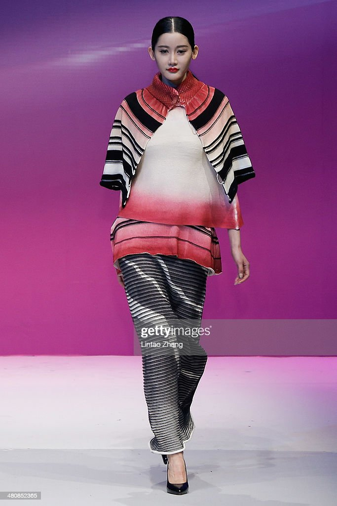 A model showcases designs on the catwalk during the WSM China Knitwear Fashion Design Contest 2014 on the third day of Mercedes-Benz China Fashion Week Autumn/Winter 2014/2015 at the 751D-PARK Central Hall on March 27, 2014 in Beijing, China.