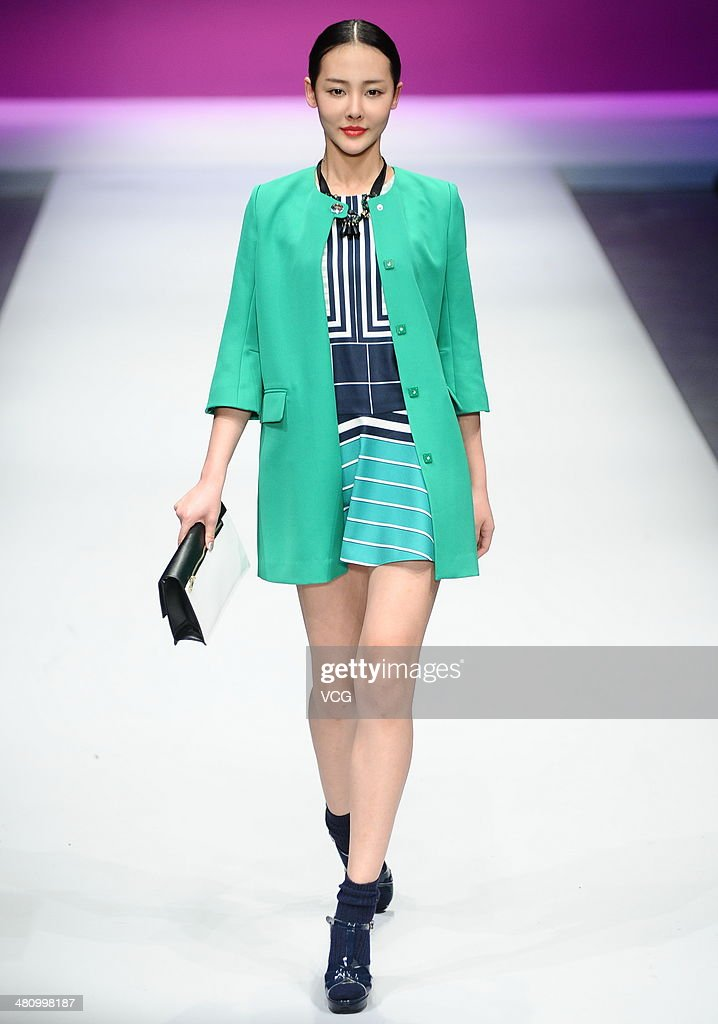 A model showcases designs on the catwalk during the WSM China Knitwear Fashion Design Contest on the third day of Mercedes-Benz China Fashion Week Autumn/Winter 2014/2015 at the on March 27, 2014 in Beijing, China.