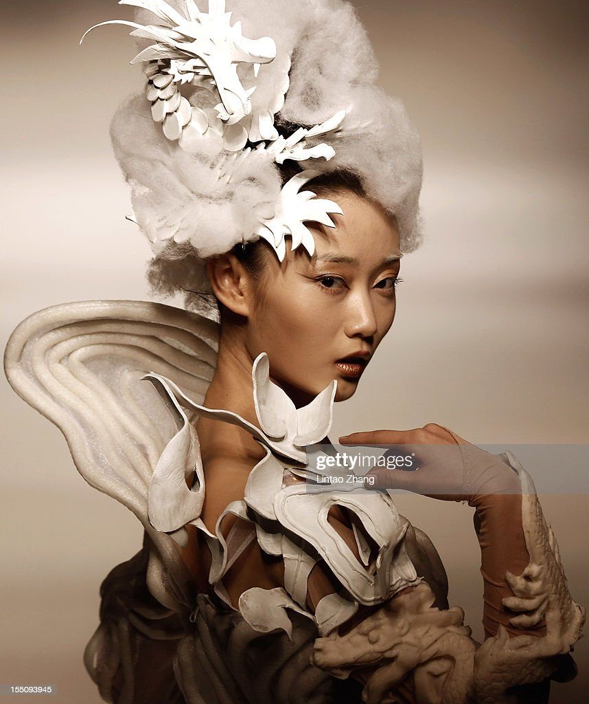 China fashion week s s collection 2013 day 8 getty images for Xuming haute couture