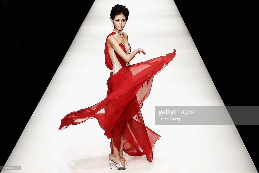 A model showcases designs on the catwalk during the Zhang jingjing Haute Couture Collection of China Fashion Week S/S Collection 2013 at 751D.PARK Workshop on October 30, 2012 in Beijing, China.