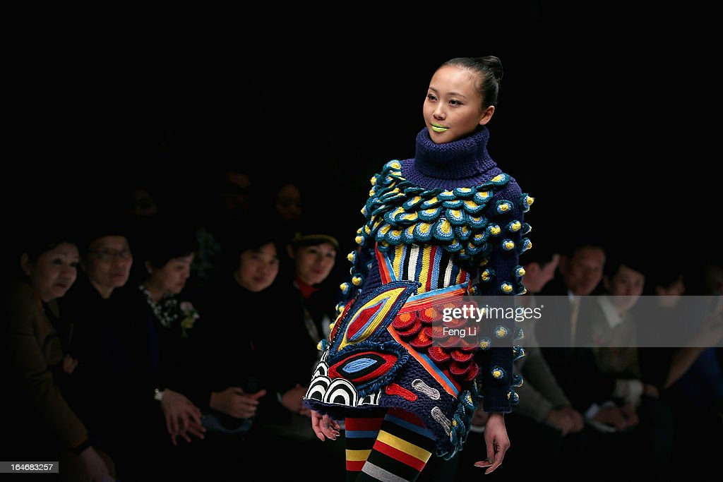 A model showcases designs on the catwalk during WSM China Knitwear Fashion Design Contest 2013 on the third day of Mercedes-Benz China Fashion Week Autumn/Winter 2013/2014 at 751 D.PARK Central Hall on March 26, 2013 in Beijing, China.