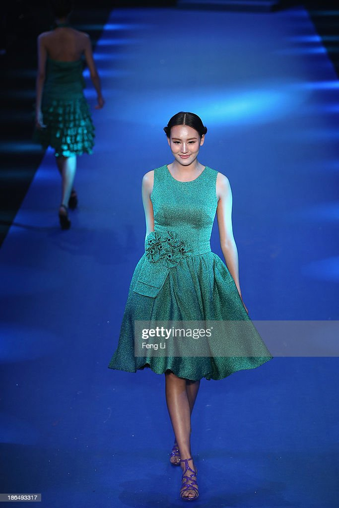 A model showcases designs on the runway at 2014 Gioia Pan & Mark Cheung Collection show during Mercedes-Benz China Fashion Week Spring/Summer 2014 at 751 D-PARK Workshop on October 31, 2013 in Beijing, China.