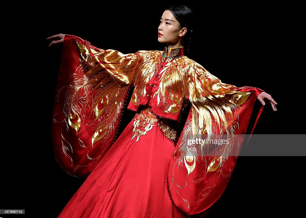 A model showcases designs on the runway at 2015 NETIGER Haute Couture Collection show during the first day of the MercedesBenz China Fashion Week...