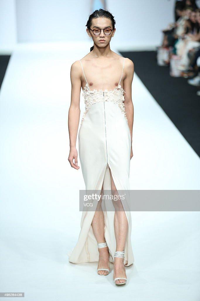 A model showcases designs on the runway at ALICIA LEE Li Kun Collection during the MercedesBenz China Fashion Week S/S 2016 Collection at 751DPARK on...