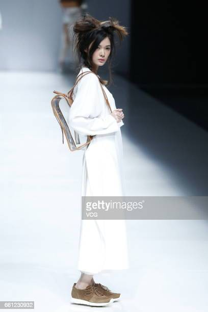 A model showcases designs on the runway at AMOYMIX WOWINGROTTO collection during MercedesBenz China Fashion Week Autumn/Winter 2017/2018 at Banquet...
